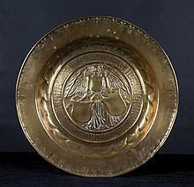 A brass alm dish.  German. Nuremberg.  Circa 1550. The centre is decor