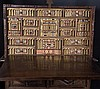 Carved polychrome and gilt walnut chest on sideboard, with polychrome bone