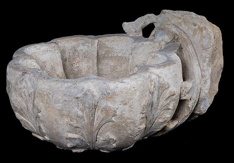 Sculpted stone font. Possibly Italian. 15th century. 26 x 52 x 40 cm.