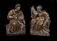 Saint Mark and Saint Luke.  Pair of carved gilt and polychrome wooden relie