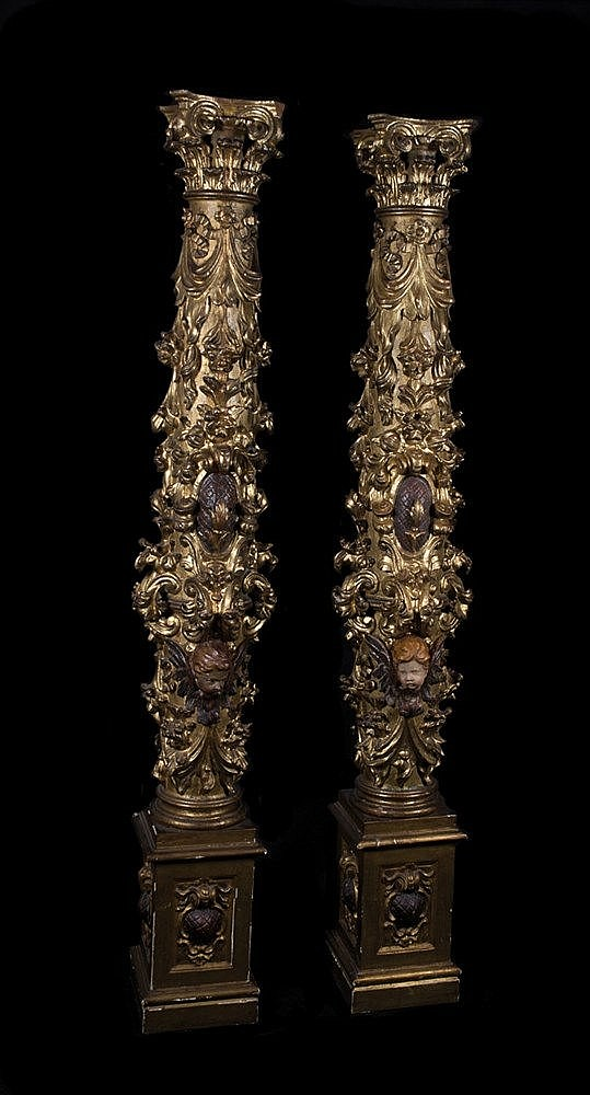 Pair of carved gilt and polychrome columns. 16th century. Profuse and de
