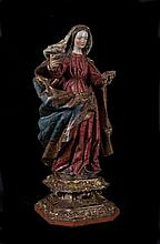 Saint Apollonia.  Carved gilt and polychrome wooden sculpture.  17th centur