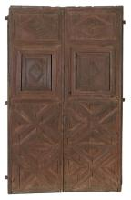 Carved wooden double door with iron fittings.  16th century.