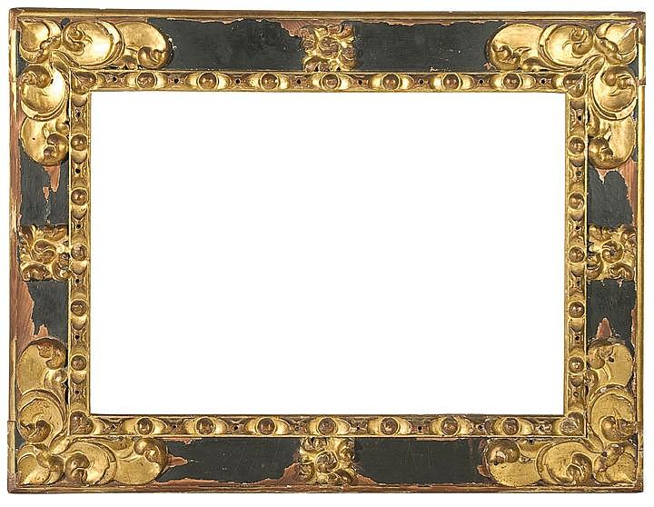 Marco en madera tallada, dorada y pintada. Siglo XVII.