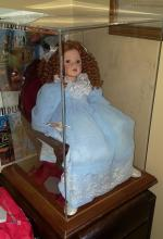 CASED DOLL