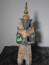Thai kneeling buddha.