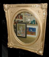 Old ornate gilded frame with mirror. Frame is 31