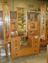 Victorian oak vanity with side folding mirrors. Back mirror attached with incorrect brackets