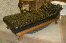 CA 1900 oak frame fainting sofa with black leather tufted upholstery