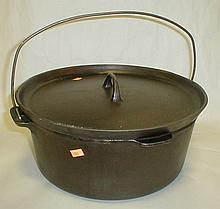 Cast iron Dutch oven with lid. 12