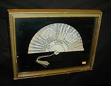 Japanese fan displayed in frame under glass. Gifted in 1908. 10.5