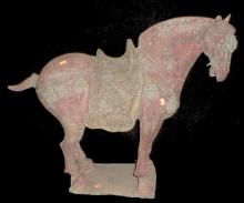 Chinese Tang style painted horse. Standing foursquare on rectangular base. Body painted with red pigments and tack highlighted with green. 23.75