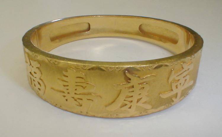 Chinese 22k gold hinged bangle 49.0 grams. Estimate $1900- 2600