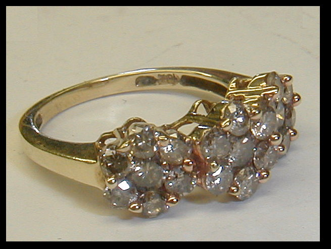 Ladies 10k yellow gold diamond cocktail ring. Set with 21 rbc stones. Mostly I2 & I3. Size 7. Total weight 3.8 grams
