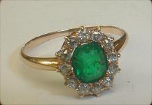 Ladies small 14k yellow gold ring with emerald and 12 old cut diamonds. Size 5 1/2. Total weight 1.5 grams. Note flaws in emerald and age related wear