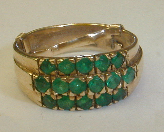Ladies 18k yellow gold ring with 16 Columbian emeralds. has original box and paper certificate. total weight 5.7 grams
