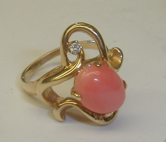 Ladies free form 14k yellow gold ring with pink coral cabochon and small rbc diamond . Size 6. Total weight 6.7 grams