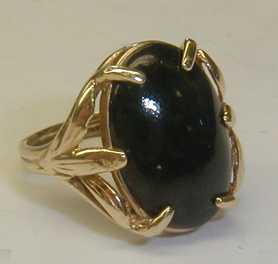 Ladies yellow gold ring set with black onyx cabochon stone. Band is marked 10k and under stone marked 14k. All acid test results are 14k. size 6 1/2. Total weight 4.4gr