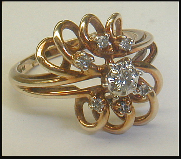 Ladies free form 14k yellow gold ring with seven diamonds. Size 6 1/2. 3.7 grams