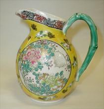 Chinese yellow ground Famille Juane porcelain pitcher. Artist signed by handle. 6.5
