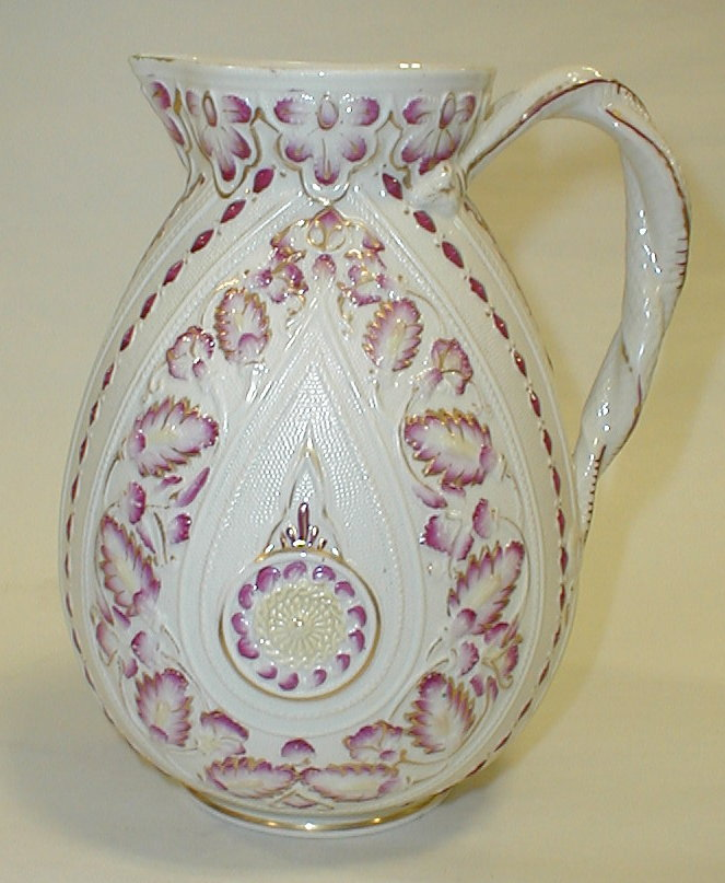 19th Century English porcelain pitcher by William Brownfield. Embossed with leaf pattern, highlighted with red and gold. 7