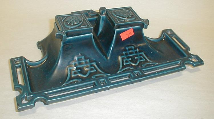 Blue enameled cast iron ink well. 10.25