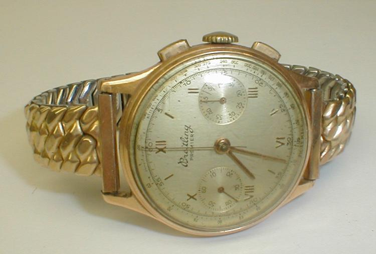 Breitling Premier Vintage men's wrist watch with the Swiss Helvetia 18k gold hallmark. Serial number 647613. Runs. Wear spots on back plate from removal. Scratches on crystal. Small spots on face.