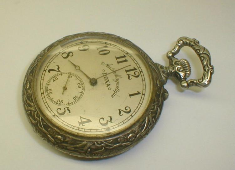 DOXA Anti Magnetique large pocket watch with hunt scene on case. In side reads: Medialle d'or Milan 1906, Hors concours Liege 1905. Not running.