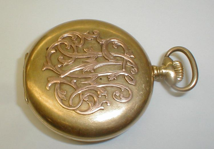Pocket Watch: Seikosha SKS in case marked SKS 18k. Not running. No crystal. Some dents on case