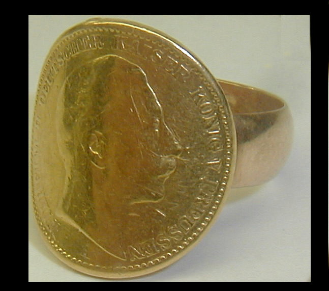 Ring made from a bent Prussia 20 Mark gold coin. Band is marked