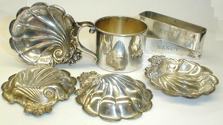 Sterling: pair of napkin rings , baby cup and set of four shell form 2 7/8