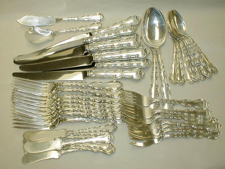 Gorham Strasbourg sterling flatware service for eight with four serving pieces. pat'd 1987. Total weight excluding knives is 49.97 troy ounces.