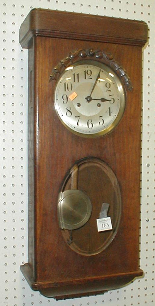 Key wind vintage oak wall clock with pendulum and key. Runs. 31.5