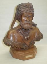 Glenn E Emmons Washington artist. A walnut sculpture of a mountain man. Titled