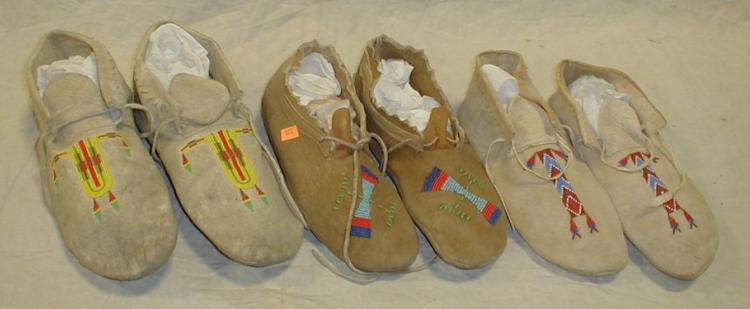 Three pairs of Native American Northern Plains moccasins. largest 11.5