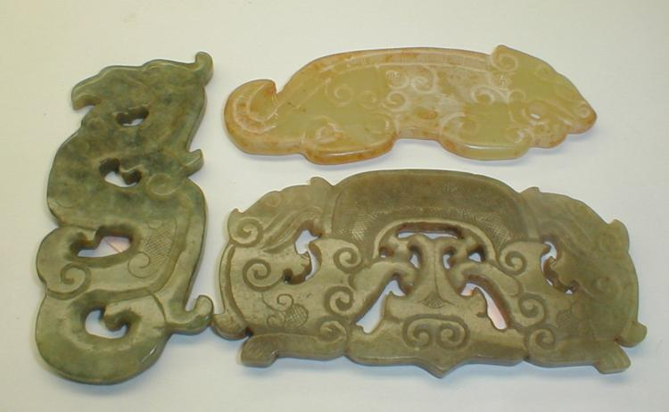 Three Chinese Jades. Yellow archaic tiger, green phoenix and double dragon necklace ornament. Longest is 3 1/16