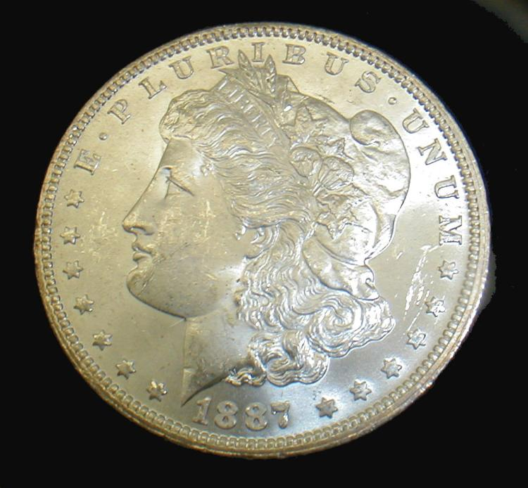 1887-O Morgan silver dollar. Approximate grade MS-61 or 62. bag marks