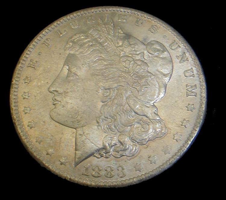 1883-O Morgan silver dollar. Toned