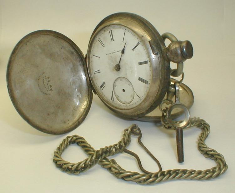 Elgin pocket watch. Serial number 905335. key wind model. Displayed in warranted coin silver case. Missing crystal and two hands. ca 1881 not tested