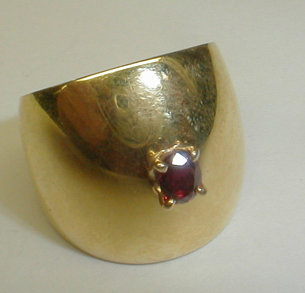 Un-marked 20k yellow gold ring with red stone. 17.3 grams Auction estimate $500-600 Size is difficult to determine exactly due to width. It approx 9 3/4 to 10