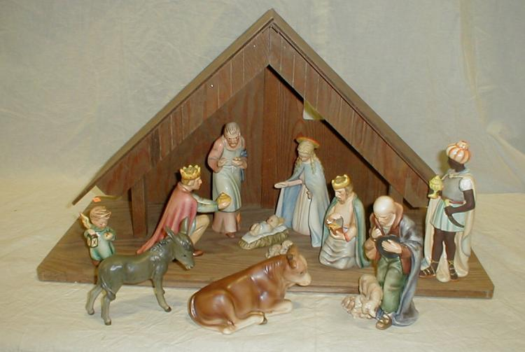 Eleven piece Large Hummel Goebel Nativity Set with Wood Manger. Marks are 1957-1963 W. Germany. Manger is 26x12x14 one chip on corner. Mary is 6.5