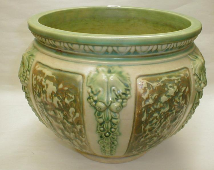 Roseville Florentine large jardiniere, circa 1924. No chips, has old stress crack (see photo). 13