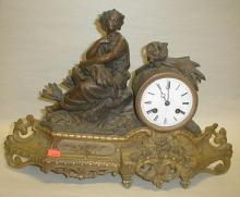 French Neoclassical figural mantel clock. Constructed of patinated spelter. 16.75