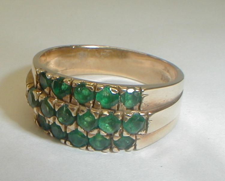Ladies 18k yellow gold ring with 16 Columbian emeralds. has original box and paper certificate. total weight 5.4 grams. Size 8