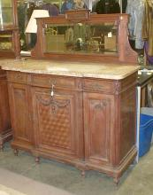 French Marble top side board with mirrored back splash. Constructed of solid walnut with oak interior woods. 55.5