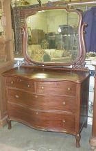Four drawer serpentine front mahogany chest with mirror. ca 1920's