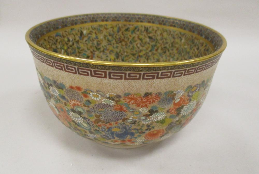 """A MEIJI JAPANESE THOUSAND BUTTERFLY AND MILLE FLEURS BOWL. INTRICATELY DECORATED WITH ENAMELS AND GILT, INSIDE WITH MULTI-COLOR BUTTERFLIES AND EXTERIOR WITH FLOWERS. 4 3/4"""" DIAMETER, 2 5/8"""" TALL"""