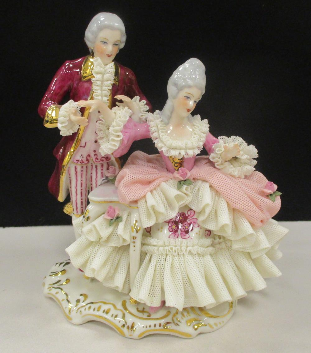 """DRESDEN LACE PORCELAIN FIGURE OF AN 18TH CENTURY COUPLE. The lady is seated at her vanity desk with a gentleman beside her. 6"""" tall"""
