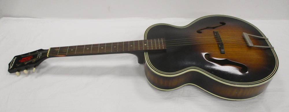 HARMONY MODEL H1515 ACOUSTIC ARCH TOP GUITAR, STEEL REINFORCED NECK. Condition: see photos for assorted wear on edges and finger board from use. Small dent near tuning pin