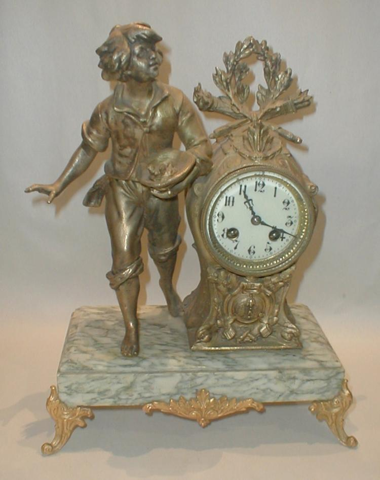 French Figural Mantle Clock on marble base. 14.5